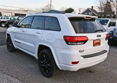 Rear Driver Side Exterior of White 2017 Grand Cherokee Altitude