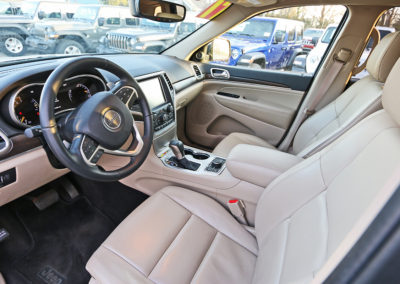 Driver Side Interior of Silver 2017 Grand Cherokee Limited
