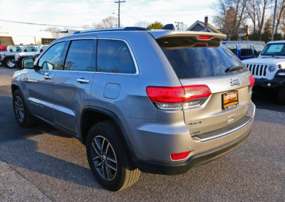 Driver Side Rear Exterior of Silver 2017 Grand Cherokee Limited
